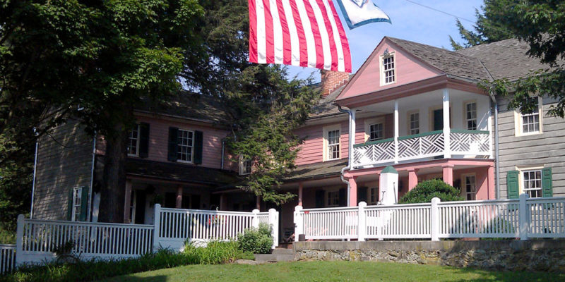 Union Mills historic house and flags